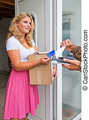Housewife accepting package