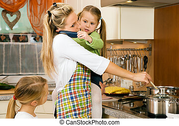 Mother with children having a lot of stress doing the homework