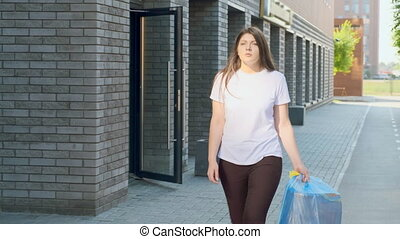 Housewife carries home trash outside
