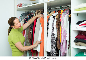 Housewife checking apparel at home - Happy housewife...