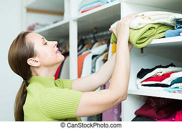 Housewife checking apparel at home - Positive smiling...