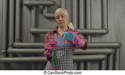 Housewife cleaning with spray bottle and sponge