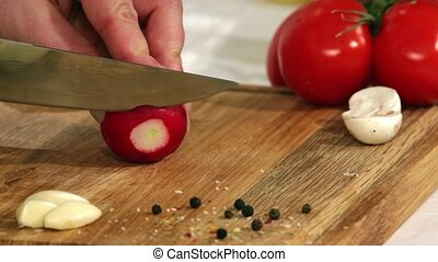 Housewife cutting radish salad. - Woman cuts radish salad on...