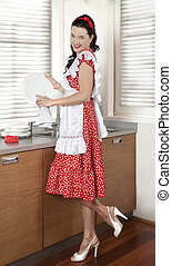 Housewife drying dishes in kitchen