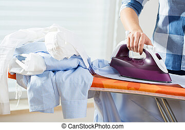 Housewife during ironing at home