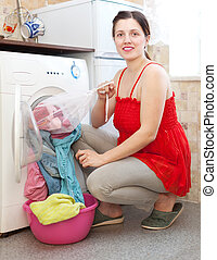 housewife  in red  with laundry bag