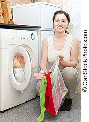 housewife in white with laundry bag