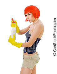 Serious woman shooting with boutle of detergent