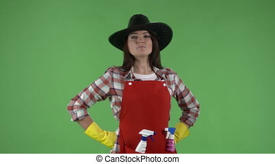 Housewife like a cowboy doing housework spraying detergent...