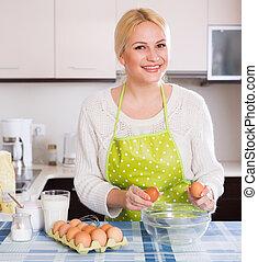 Housewife making dough