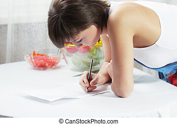 Housewife making notes