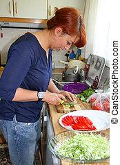 housewife making salad