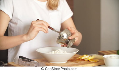Housewife mixing cottage cheese and corn in bowl. Frying pan with roasted chicken kebab standing on the stove. everything is ready for meeting husband for dinner.