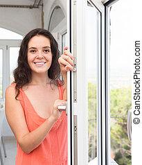 Housewife near window