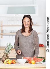 housewife preparing fruit salad
