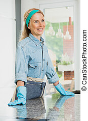 Housewife relies on a counter top - Happy housewife with...