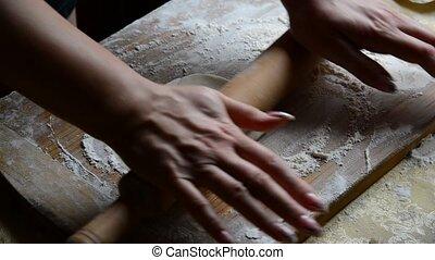 Housewife roasts chebureks in pan - Georgian national dish -...