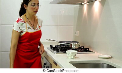 Housewife making tea in the kitchen
