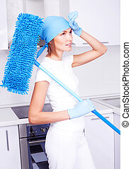housewife with a mop - beautiful tired young housewife with...