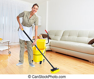 Housewife with broom. - Smiling housewife cleaner with broom...