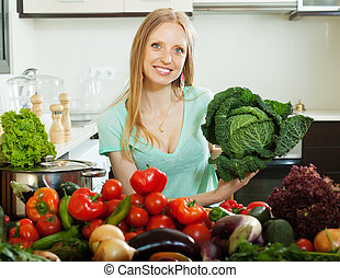 housewife with cabbage and other vegetables