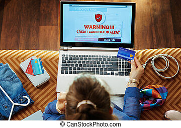 housewife with credit card making secure online shopping