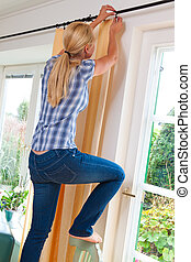 Housewife with curtains. Accident in the home. Domestic...
