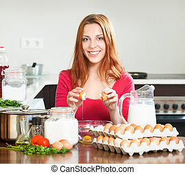 housewife with eggs in home kitchen