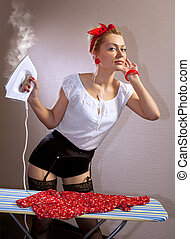housewife with iron - Beautiful House Wife Ironing A Red...