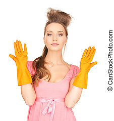 housewife with protective gloves - picture of beautiful...