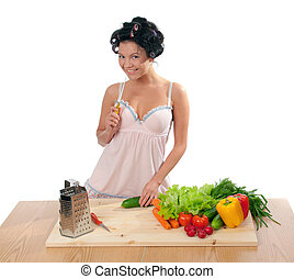 Housewife with vegetables .Studio, white background.