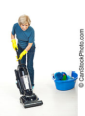 Housewife working with vacuum cleaner - Senior housewife ...