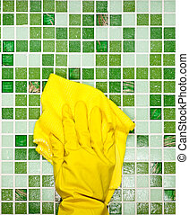Housework - Hand in yellow protective glove cleaning mosaic...