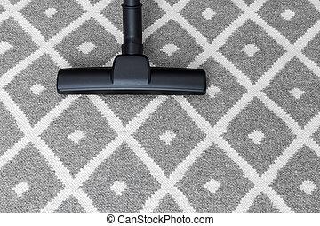 Vacuum cleaner on gray carpet - Housework. Vacuum cleaner on...