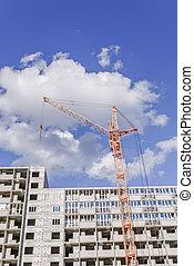 housing construction. crane. new home. blue sky