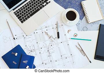 Housing plan blueprint on desk - High angle view of modern ...