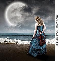 housle, na pláži