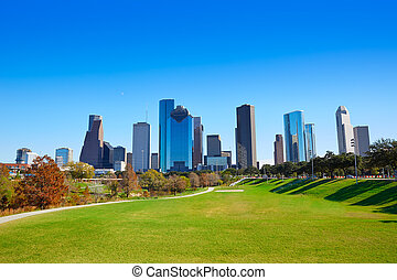 Houston skyline in sunny day from park grass of Texas USA