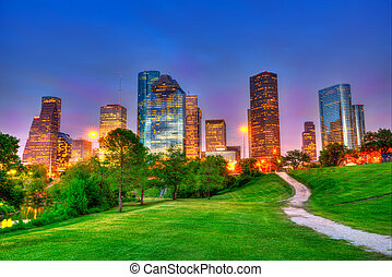 Houston Texas modern skyline at sunset twilight on park - ...
