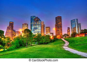 Houston Texas modern skyline at sunset twilight on park -...