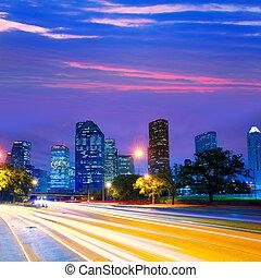 Houston Texas skyline at sunset with traffic lights
