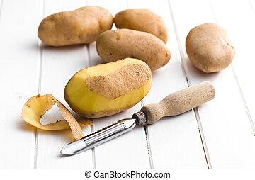 houten, aardappels, peeler