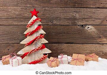 houten, kerstboom, met, rustiek, rood, guirlande, in, sneeuw