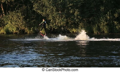 Hover board rider.Fly board rider. - Young man on the Hover...