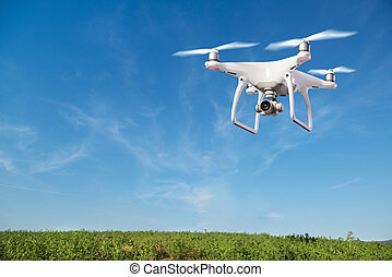 Hovering drone taking pictures of green hills - Close up of ...