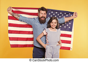 How do americans celebrate independence day. Patriotic family cheerful and friendly. Independence day holiday. Independence is happiness. Father bearded hipster and cute little daughter with USA flag