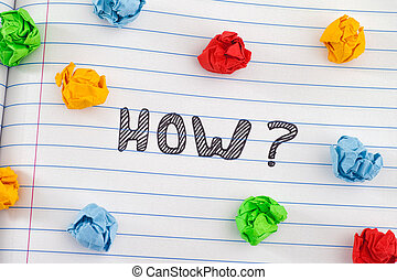 How question on notebook sheet with some colorful crumpled paper balls around it