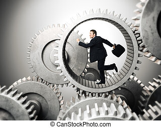 how it works - businessman running inside of metal gear