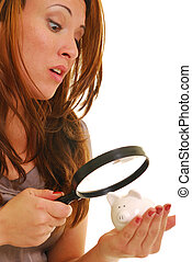 How much money? - Beautiful woman using a magnifying glass...