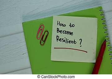 How to Become Resilient? write on sticky note isolated on Wooden Table.